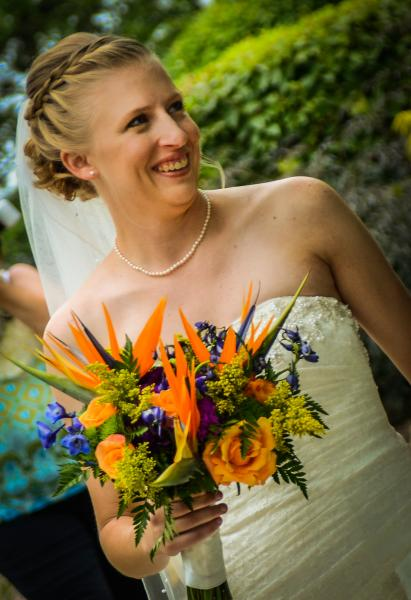 [Image: colorful bridal flowers with exotic birds of paradise]