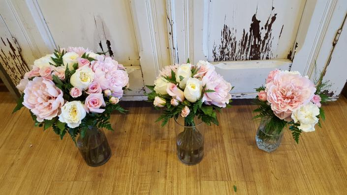 [Image: Pretty in pink & white! we created this look using fresh and silk flowers!! the peonies in this picture are silk since they were not in season and the bride had to have them! they look real!]